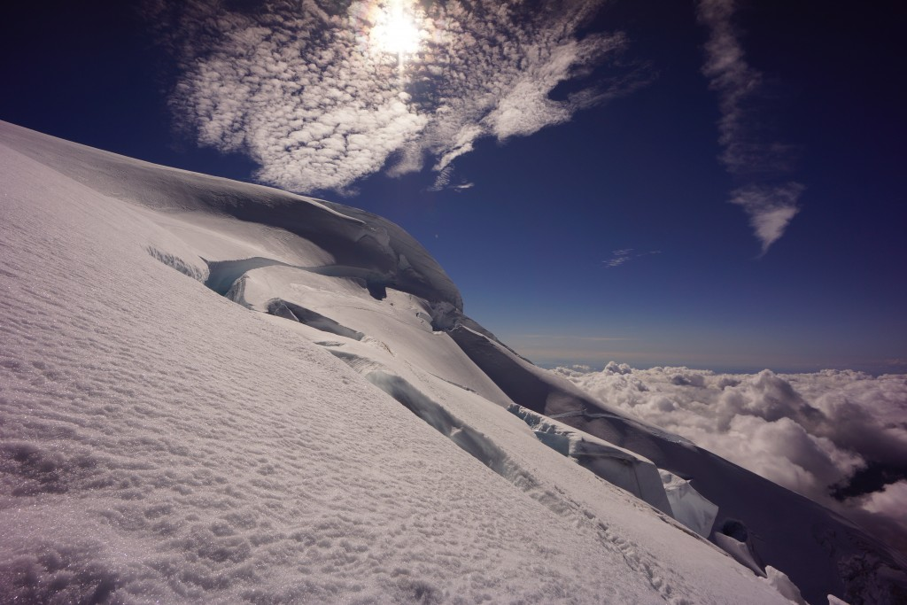 Near the top of Baker after completing the traverse above the highest bergshrund.  This is one variation on the upper portion of the route.  The other option is to go up the right skyline in the picture.  Photo: Zeb Blais