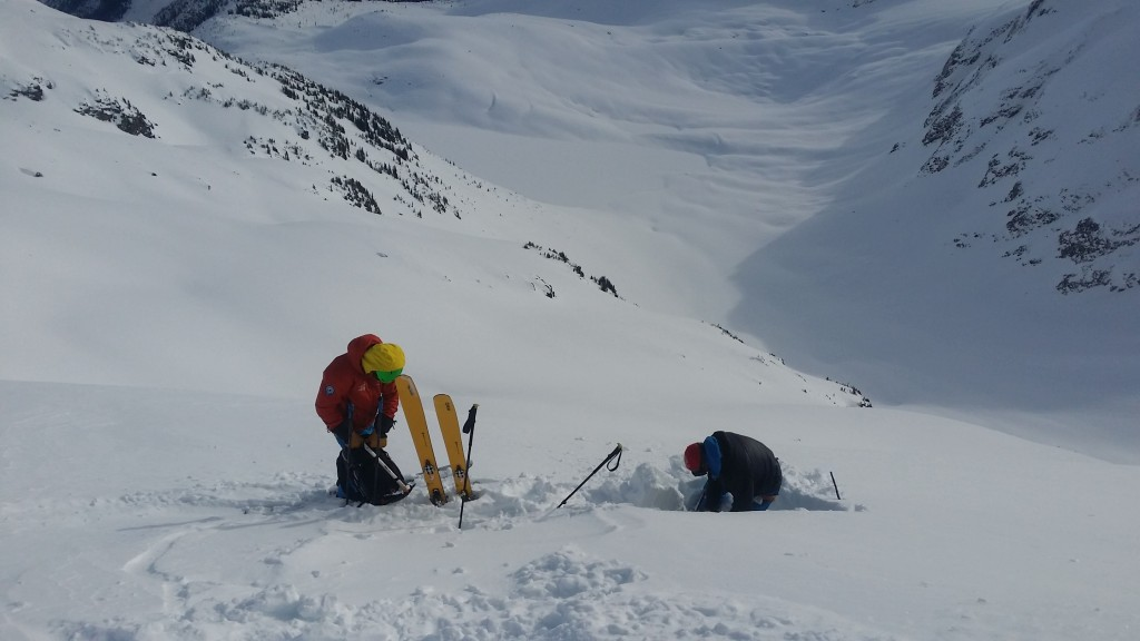 Rogers Pass. Assessing the snowpack before committing to a big face.