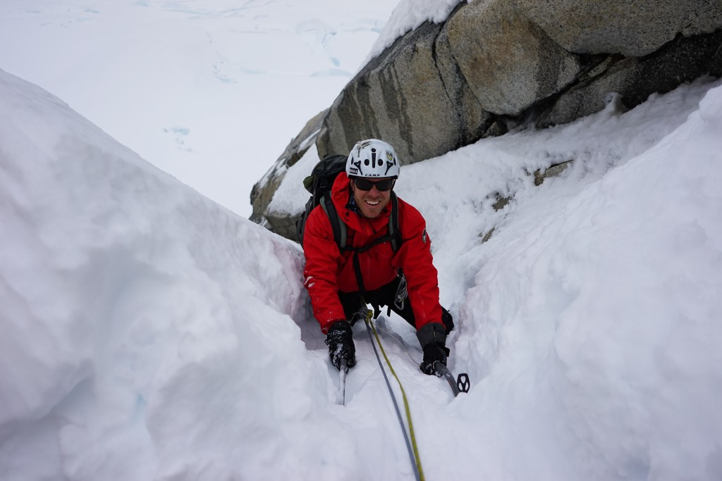 Climbing Patagonia. Jeb topping out on the snow and ice couloir of the Amy-Vadallet. Photo: Zeb Blais.